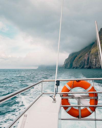 Sailboat on sea against sky