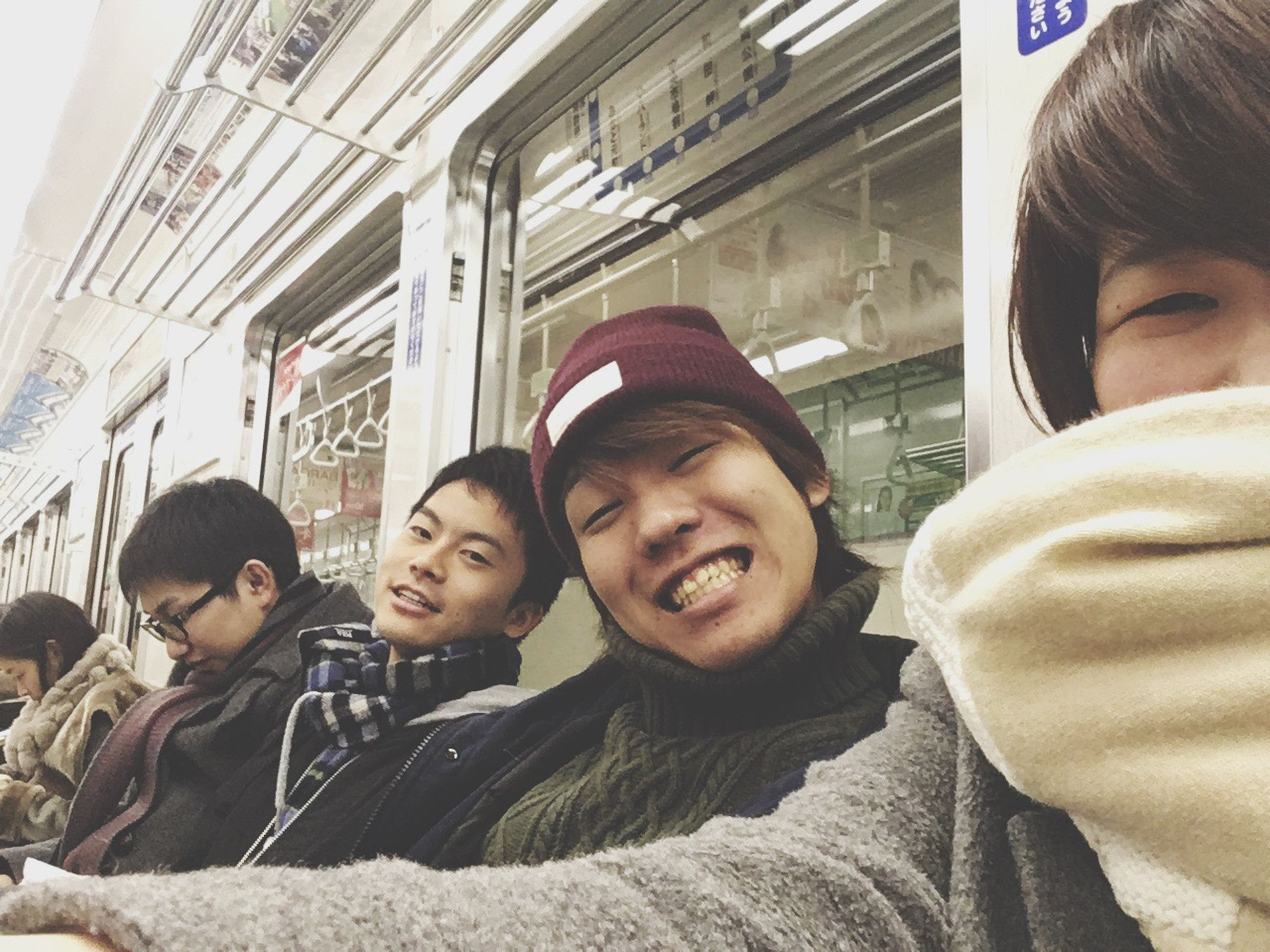 young adult, travel, adults only, passenger, togetherness, adult, young women, friendship, subway train, people, indoors, public transportation, women, men, day, human hand, headwear