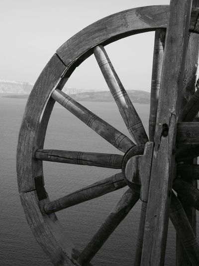 Santorini, Greece Black And White Close-up Day Helm Mill Wheel Nature No People Outdoors Sea Sky Wheel Wood - Material