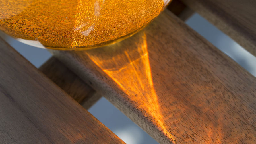EyeEm Gallery Liquid Orange Part Of Reflection Sunlight Bubble Bublles Close-up Glass Glass - Material Indoors  Object Orange Color Water Wood - Material