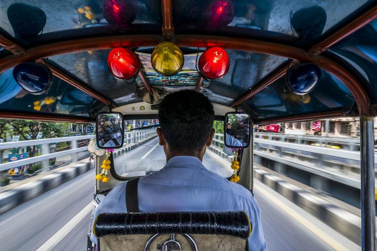 Rear view of man driving jinrikisha