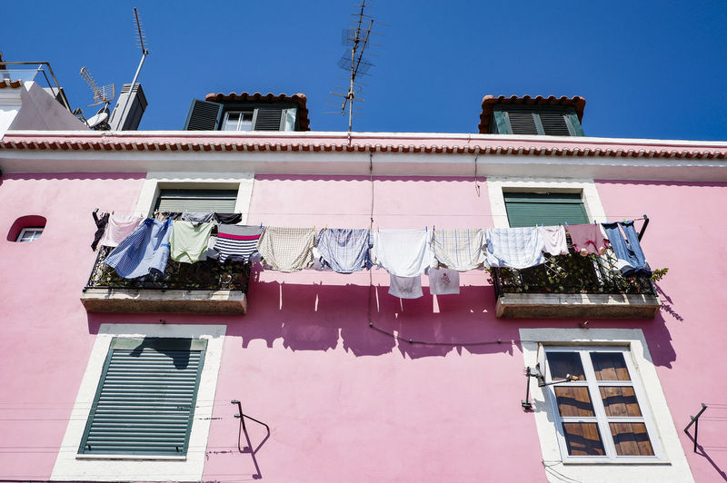 Low angle view of clothes drying at building