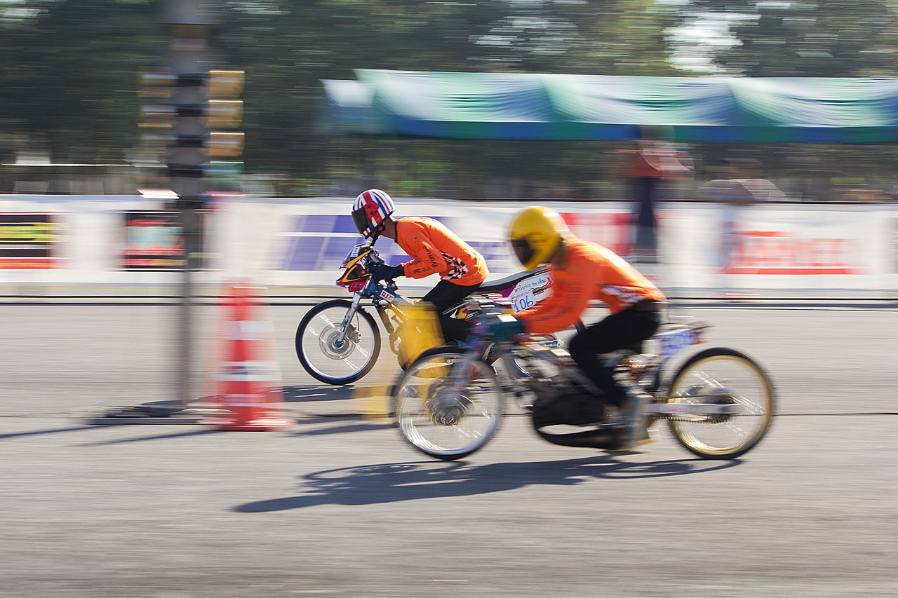motion, blurred motion, transportation, sport, competition, speed, men, real people, sports race, bicycle, mode of transportation, ride, riding, activity, people, athlete, lifestyles, land vehicle, excitement