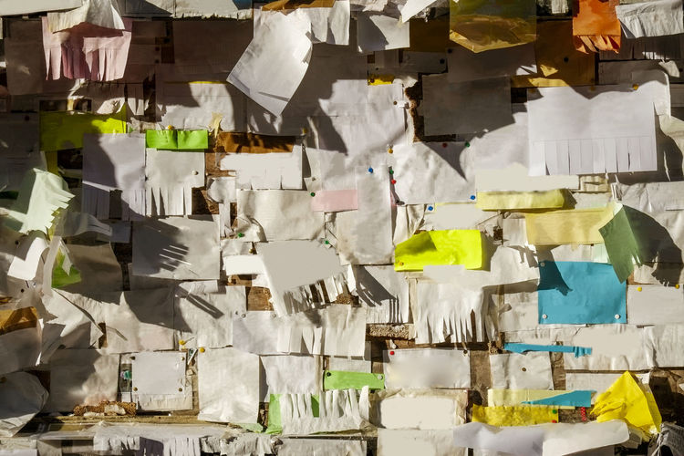 Bulletin board outside a university full of personal announcements Bulletin Board Adhesive Note Announcements Architecture Backgrounds Board Built Structure Bulletin Communication Damaged Day Destruction Full Frame Hanging In A Row Large Group Of Objects Message Messy No People Note Outdoors Paper Text Torn Wall - Building Feature
