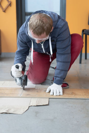 Carpenter working on floor at home
