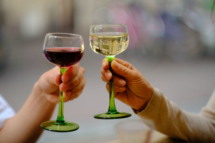 Close-up of hand holding glass of wine glasses