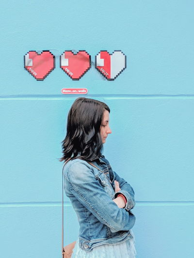 hearts shaped Girl Youth Culture Young Adult Colorful NYC City Citylife Wall Art Street Art Wall Hairstyle Jeans Style Cool Attitude Fashion Mural Graffiti Women Technology Young Women Red Communication Love Headshot Profile View Heart Shape Thoughtful I Love You Posing The Portraitist - 2019 EyeEm Awards The Mobile Photographer - 2019 EyeEm Awards The Creative - 2019 EyeEm Awards My Best Photo