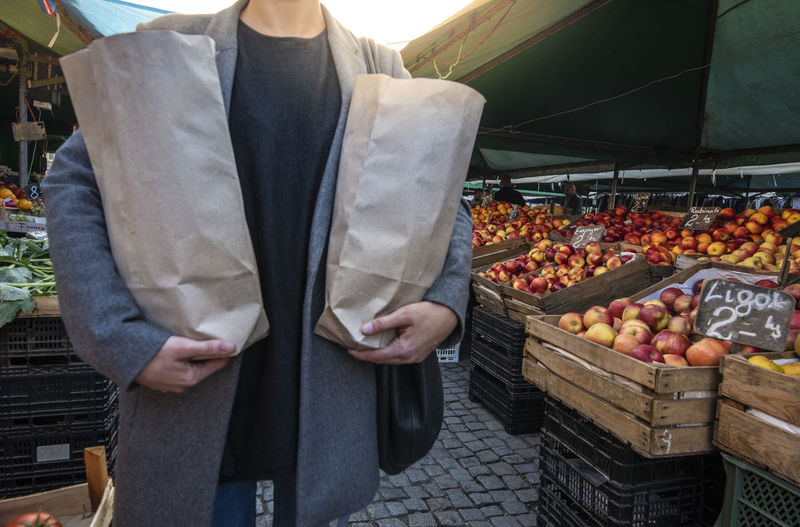 Midsection of man standing at market stall
