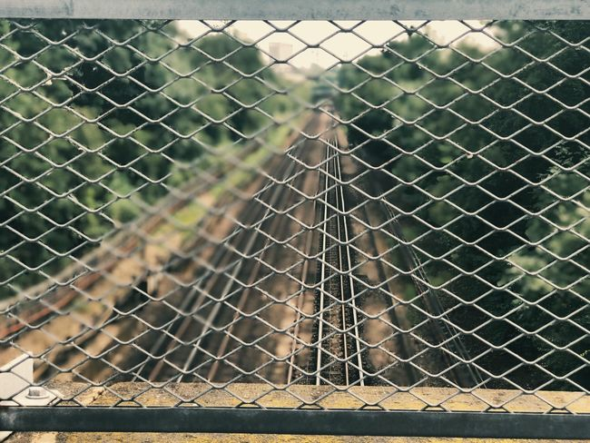 Chainlink Fence Safety Protection Metal Security Day Outdoors No People Close-up Prison Railway Railway Track London Unseen London Underground Tube London Underground Bridge Blue Sky