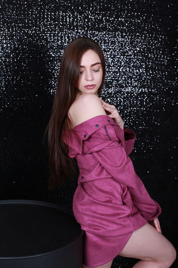 Sexygirl Sensual_woman Pink Color Pink Dress Black Background Balloons Decoration One Person Young Adult Three Quarter Length Young Women Indoors  Clothing Looking At Camera Real People Fashion Standing Women Portrait Front View Casual Clothing Looking Hairstyle Beautiful Woman Purple