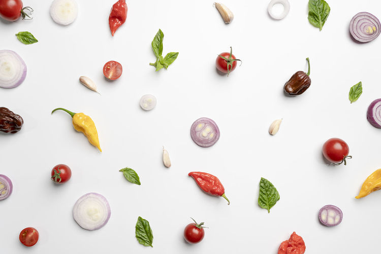 High angle view of multi colored candies on white background