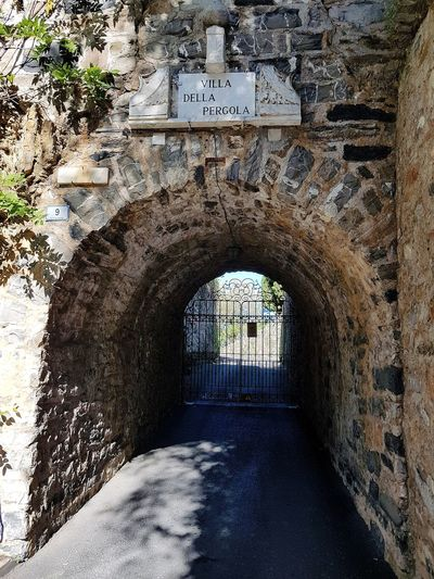 Arch Architecture Day Built Structure The Way Forward No People Liguria, Italy Outdoors Villa Villa Entrance Travel Destinations Antique Tunnel Entrance