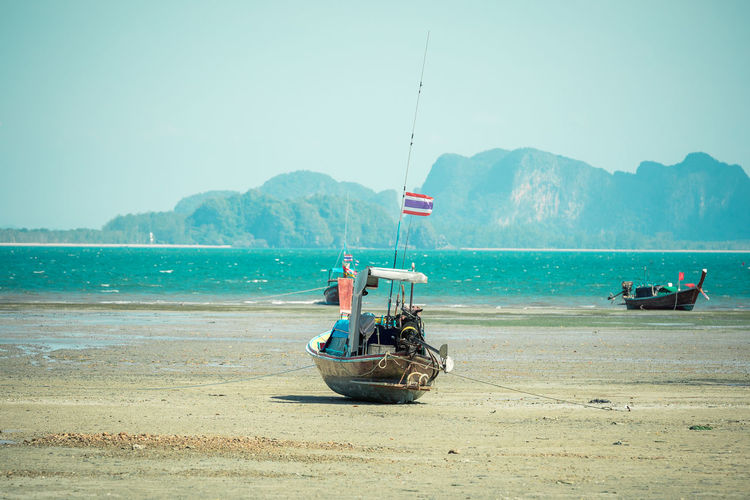 Transportation Nautical Vessel Mode Of Transportation Water Sea Sky Mountain Flag Nature Day Patriotism Clear Sky Land Beach Scenics - Nature Beauty In Nature Moored Outdoors