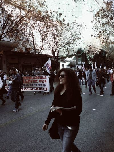 Real People Protesting Crowded Walking Flags Old Buildings Trees Streetphotography Pretty Girl Girl Smile Newspaper Girl In Motion Athens Athens, Greece