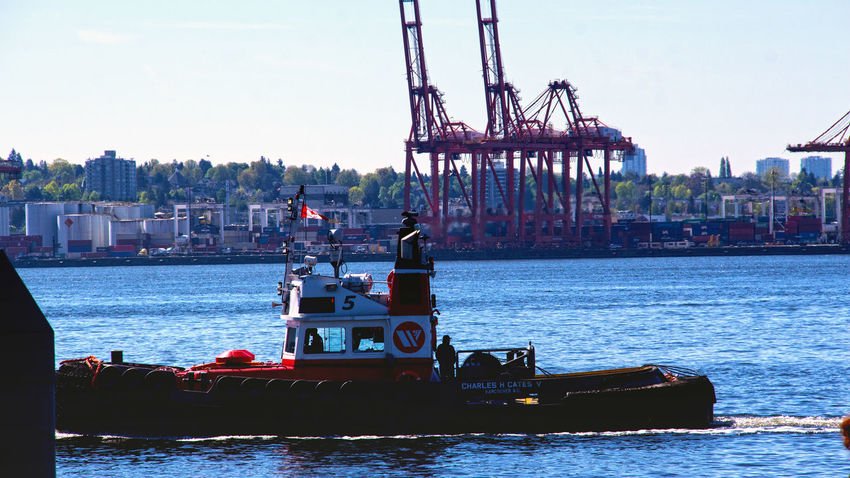 Tugboat in Burrard Inlet near North Vancouver B.C. Lonsdale Quay North Vancouver,BC Tug Boat City Water Cityscape Nautical Vessel Urban Skyline Oil Pump Ferris Wheel Sailing Ship Sailing Golf Club Harbor Boat