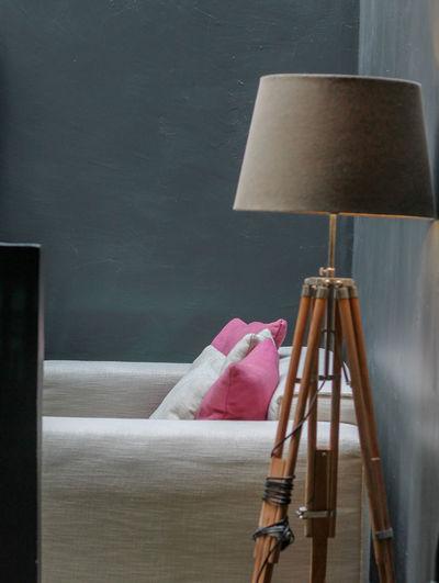 Floor lamp against sofa at home