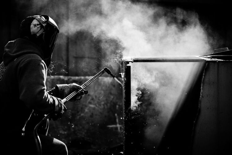 Human Meets Technology Light & Shadow Performance Skill  Smoke - Physical Structure Unrecognizable Person Welding Worker
