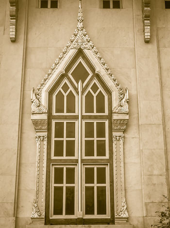 Beautiful golden window with white cement background in Thai temple. Architecture Art And Craft Building Building Exterior Built Structure Closed Day Design Door Entrance Façade Golden Window History Low Angle View No People Ornate Pattern Place Of Worship Temple Wall Temple Walls Temple Window The Past Wall - Building Feature Window Window Frame Window Sill Window View