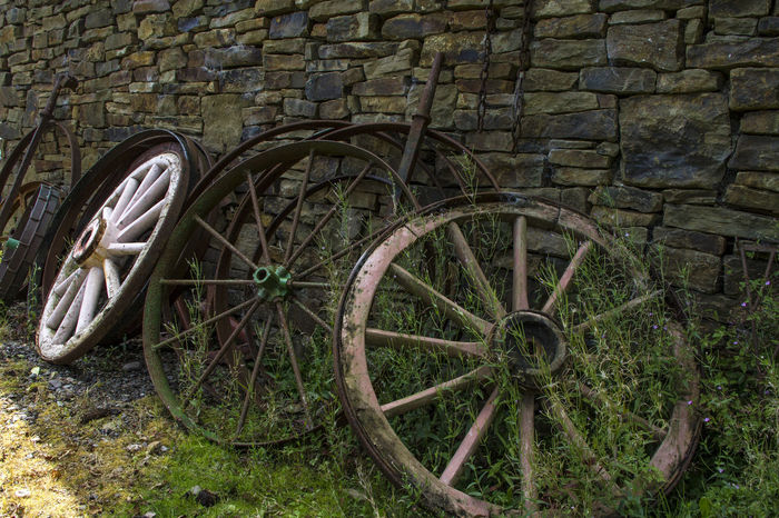 Used wheels of the past Day No People Outdoors Spoke Transportation Wagon Wheel Wheel Wood - Material