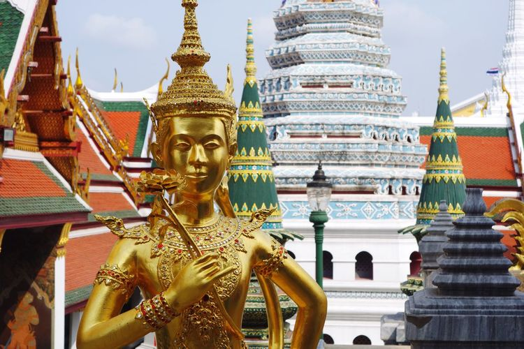 Emerald Buddha Temple Wat Phra Kaew Bangkok Wat Pho Temple Of Emerald Buddha Religion Spirituality Place Of Worship Gold Colored Architecture Human Representation Statue Built Structure Building Exterior Travel Destinations Outdoors Gold Sculpture Sky Day Traveling Travel Photography Golden