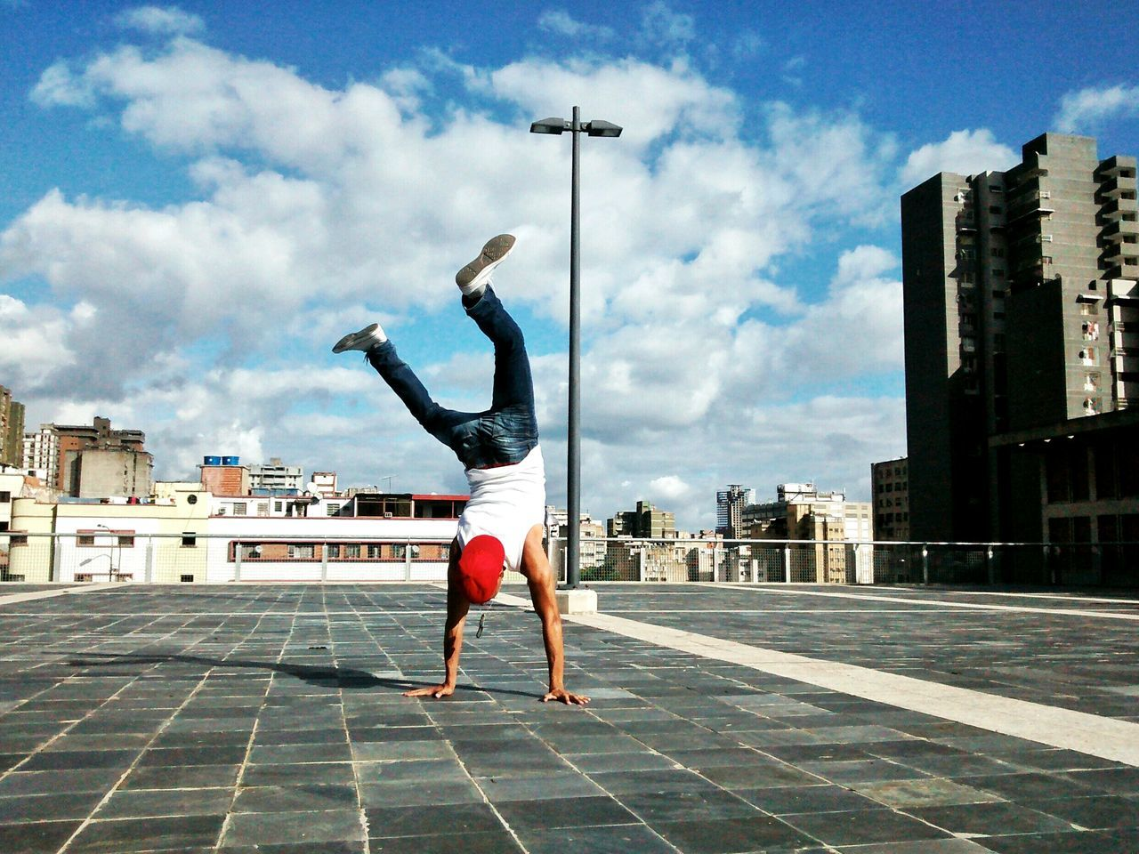 Young man doing handstand
