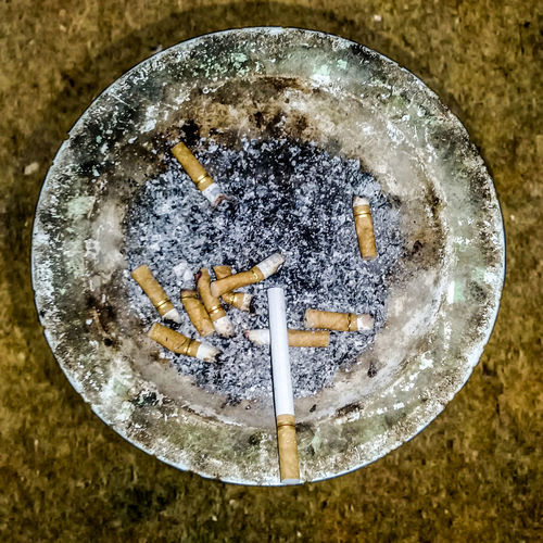 High angle view of cigarette smoking on table