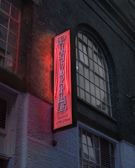 Low angle view of text on building