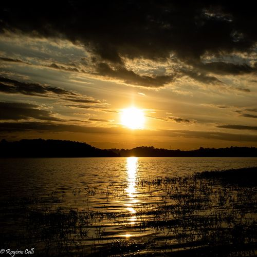 Sunset Moments Sunset Water Sky Beauty In Nature Scenics - Nature Cloud - Sky Tranquility Tranquil Scene Reflection Sunlight Sun Nature Silhouette Idyllic Orange Color No People Outdoors Non-urban Scene