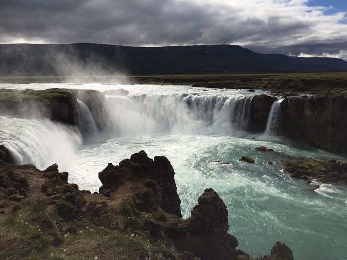 Goðafoss waterfall in iceland on a summer day with lots of clouds