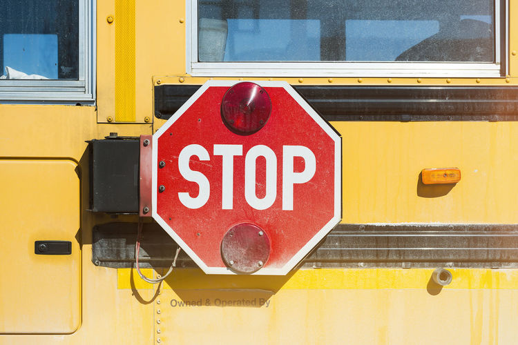 Close-up of stop sign on bus
