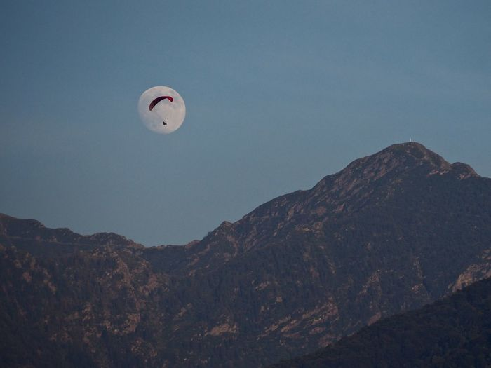 Alps Beauty In Nature Clear Sky Dusk Evening Low Angle View Man In The Moon Mid-air Moon Moonrise Mountain Mountain Range Nature Outdoors Paragliding Scenics Sky Switzerland Tranquil Scene Tranquility