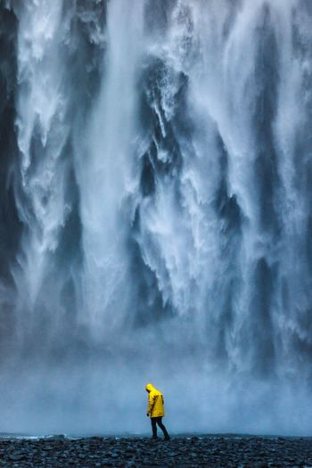 Skogafoss waterfall One Person Real People Outdoors Nature Rear View Water Day Leisure Activity Men Standing Full Length Motion Beauty In Nature Lifestyles Adventure Cold Temperature Scenics Waterfall Sky One Man Only Waterfront Waterfall Be. Ready. Perspectives On Nature