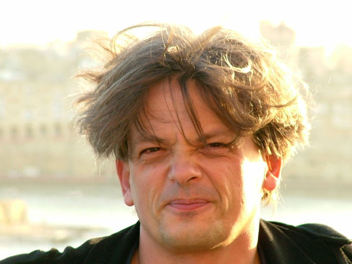 Close-up portrait of man with messy hair