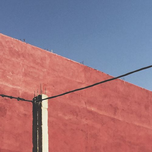 Red wall. Built Structure Blue Low Angle View Clear Sky No People Architecture Day Outdoors Building Exterior Minimalist Architecture