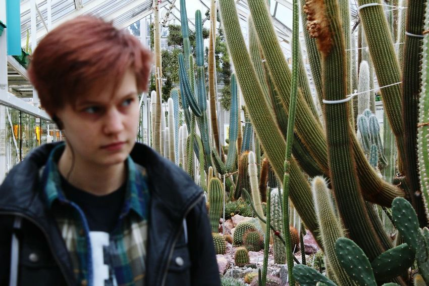 One Person People Day One Teenage Boy Only Nature Young Adult White Bright Green Indoors  Cactus Garden Succulents Cactus House Beauty In Nature Indoors  Plant Nursery Plant Growth Nature Indoors  Greenhouse Window Potted Plant Tree Break The Mold The Portraitist - 2017 EyeEm Awards BYOPaper!