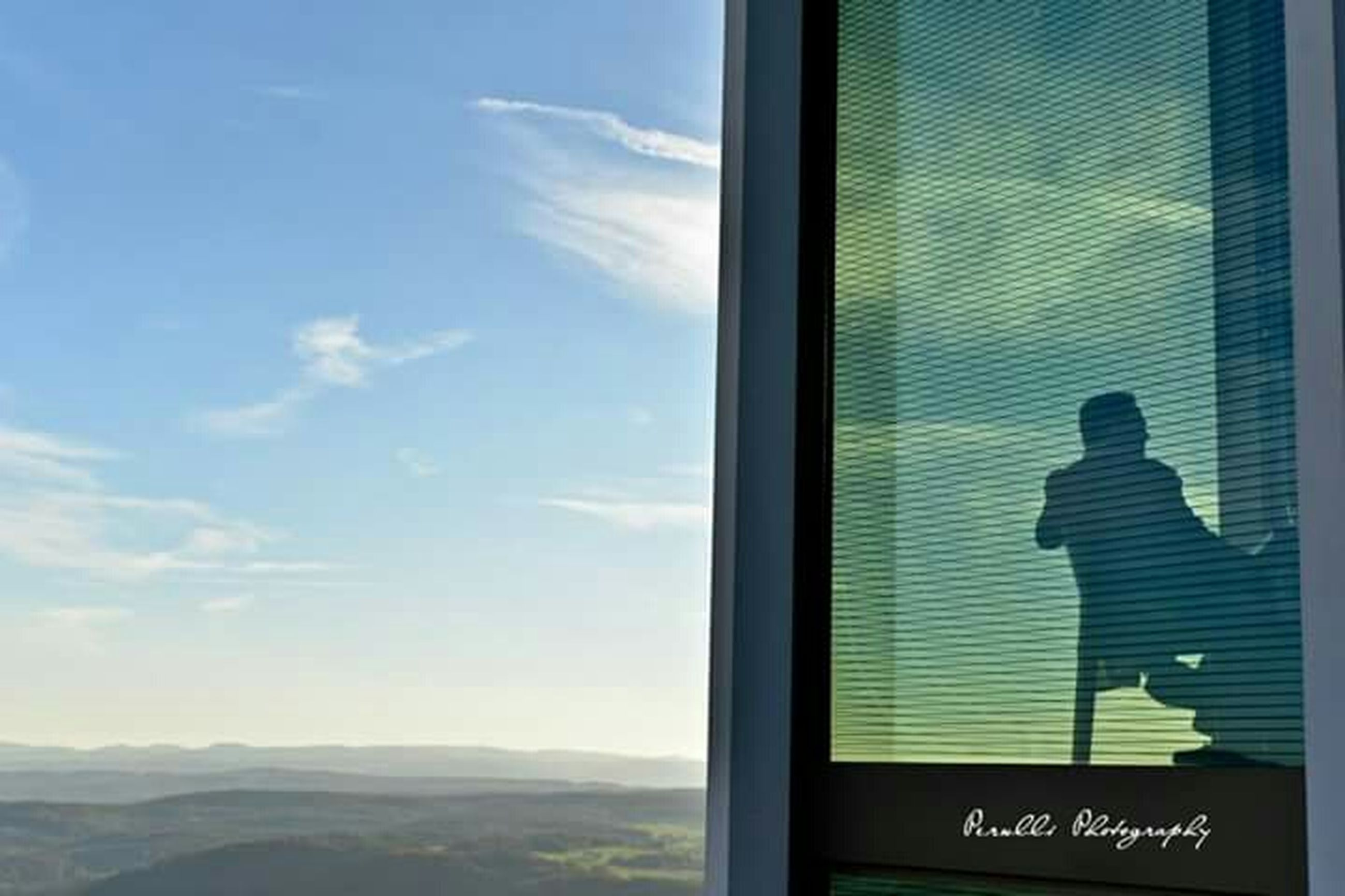 window, sky, indoors, glass - material, silhouette, transparent, day, cloud, cloud - sky, sunlight, mountain, communication, built structure, architecture, curtain, nature, looking through window, lifestyles
