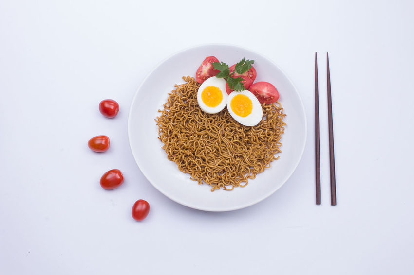 Fried noodle on a white plate styled beautifully Fried Noodles Noodles Breakfast Close-up Directly Above Egg Food Food And Drink Freshness Garnish Healthy Eating High Angle View Indoors  Meal No People Noodle Plate Ready-to-eat Still Life Studio Shot Temptation Tomato Vegetable Wellbeing