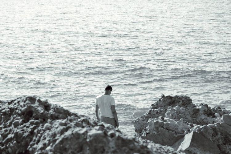Water Wave Sea Men Beach Standing Rear View Rock - Object Horizon Over Water Sky Ocean Rocky Coastline Rock Stone