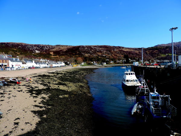 Ullapool Highlands Of Scotland Architecture Bay Beach Blue Building Exterior Clear Sky Day Incidental People Land Mode Of Transportation Moored Mountain Nature Nautical Vessel Outdoors Passenger Craft Sea Sky Transportation Travel Water