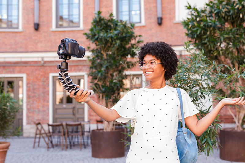 Woman Vlogging Vlogger Blogger Filming Photos Photography Outdoors Real People Smiling person Walking Posing African Glasses Digital Camera Portrait Looking