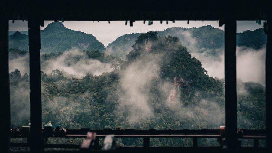 Panoramic shot of silhouette mountain against sky