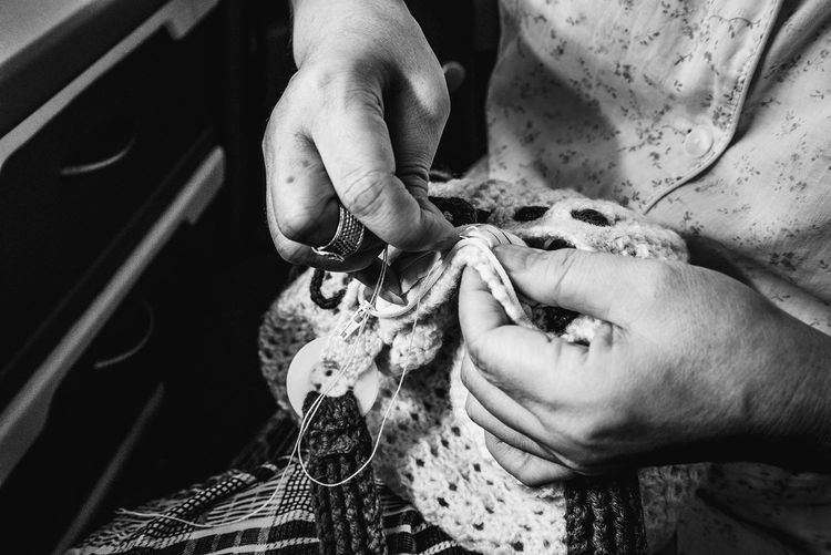 Midsection Of Woman Knitting Crochet