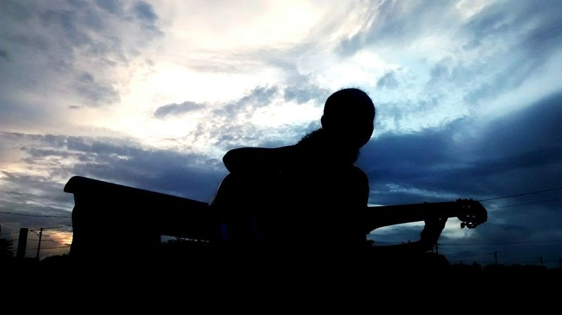 One Person One Man Only Cloud - Sky Adults Only Only Men Sitting Sport Men Outdoors Adult People Day Sky Tumblr Beauty In Nature EyeEmNewHere Nature Céus E Nuvens Violão Silhouette Solitary Moments EyeEmNewHere
