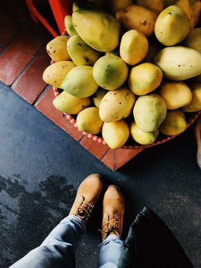 Mango My Foot Mango EyeEm Selects High Angle View Human Leg Fruit One Person Low Section Real People Shoe Day Healthy Eating Personal Perspective Food