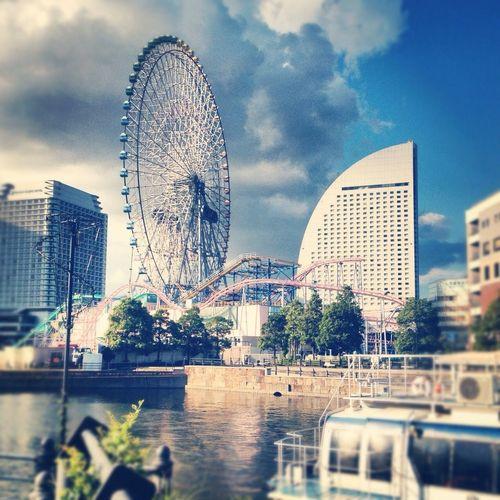 Ferris wheel against cloudy sky