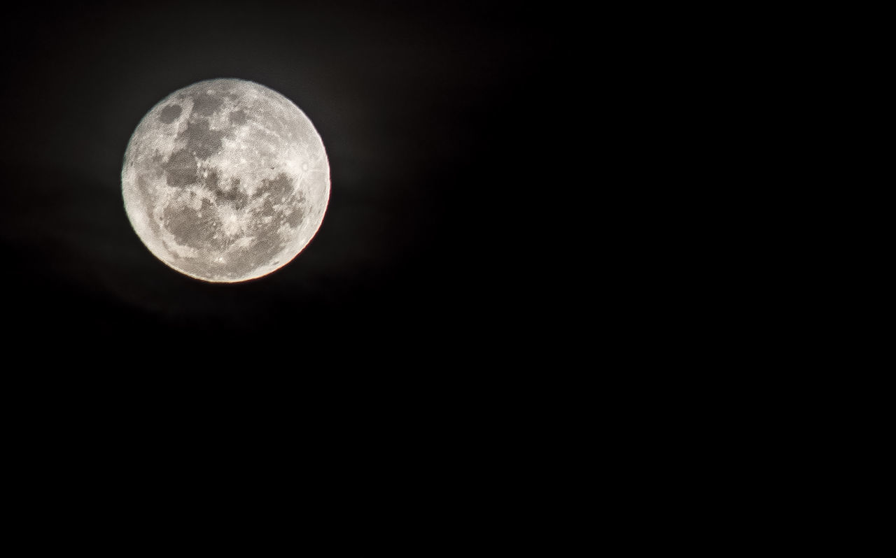 moon, night, astronomy, moon surface, beauty in nature, full moon, planetary moon, nature, scenics, low angle view, copy space, idyllic, tranquility, tranquil scene, no people, outdoors, sky, space exploration, half moon, moonlight, space, clear sky, close-up