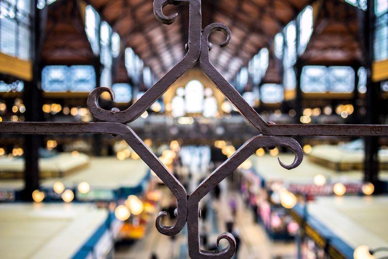 Close-up of metal railing against defocused background