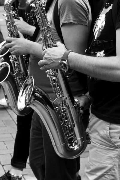The Street Photographer - 2017 EyeEm Awards Streetphotography Capture The Moment Arts Culture And Entertainment Musical Instrument Music Saxophone Musician Performance Playing Wind Instrument Adult Men Only Men Jazz Music Outdoors Performance Group Day People Adults Only 1may Blackandwhite Real People Fujifilm_xseries Acros100 The Photojournalist - 2017 EyeEm Awards Small Business Heroes