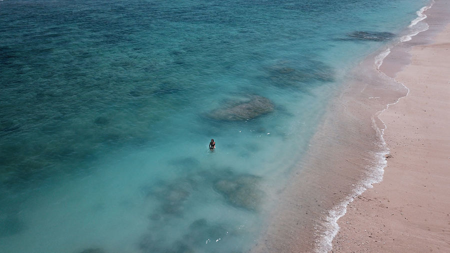 Aerial view of woman standing on beach
