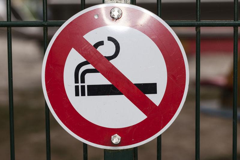 Close-up of no smoking sign
